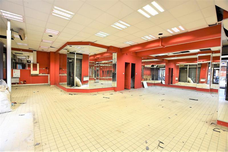 Boutique à fort potentiel commercial avec grand linéaire de vitrine - Photo 1