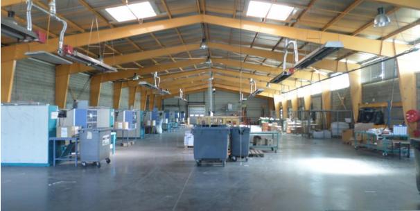 A louer à Vendargues entrepôt chauffé de 1.840 m² + 550 m² bureaux sur un terrain de 7.065 m²